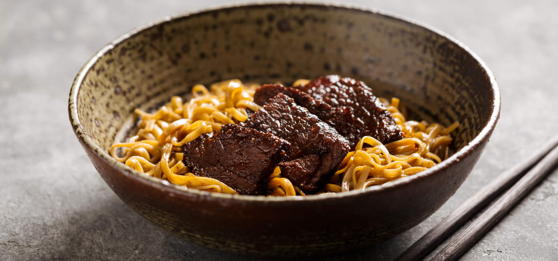 Asian noodle dish with beef in a bowl